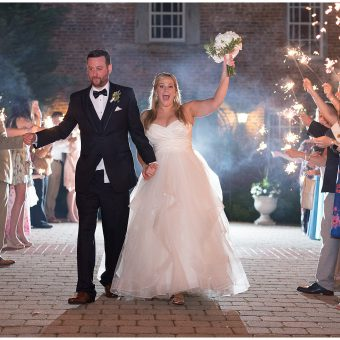 DC couple walking through a sparkler exit at The Birkby House in Leesburg, Virginia.