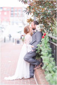 Couple sharing a kiss in Charlottesville, Virginia during the wintertime at the Downtown Mall.