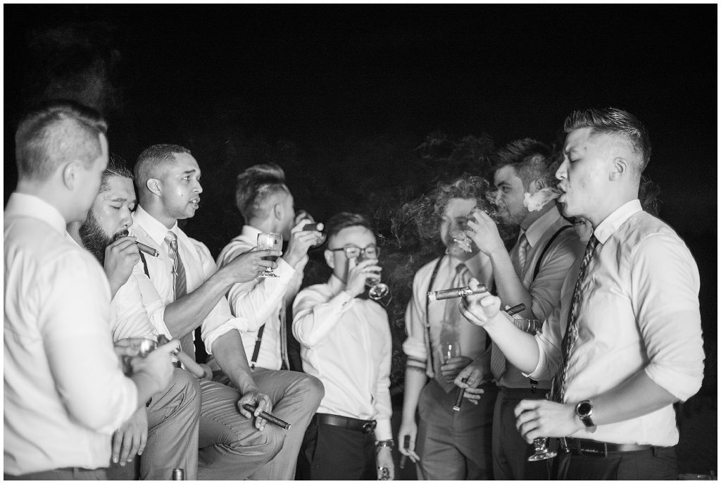 Groom having whiskey and cigars with his Groomsmen