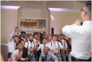 Single Men anticipating catching the garter at a wedding in Haymarket, Virginia at The Piedmont Club.