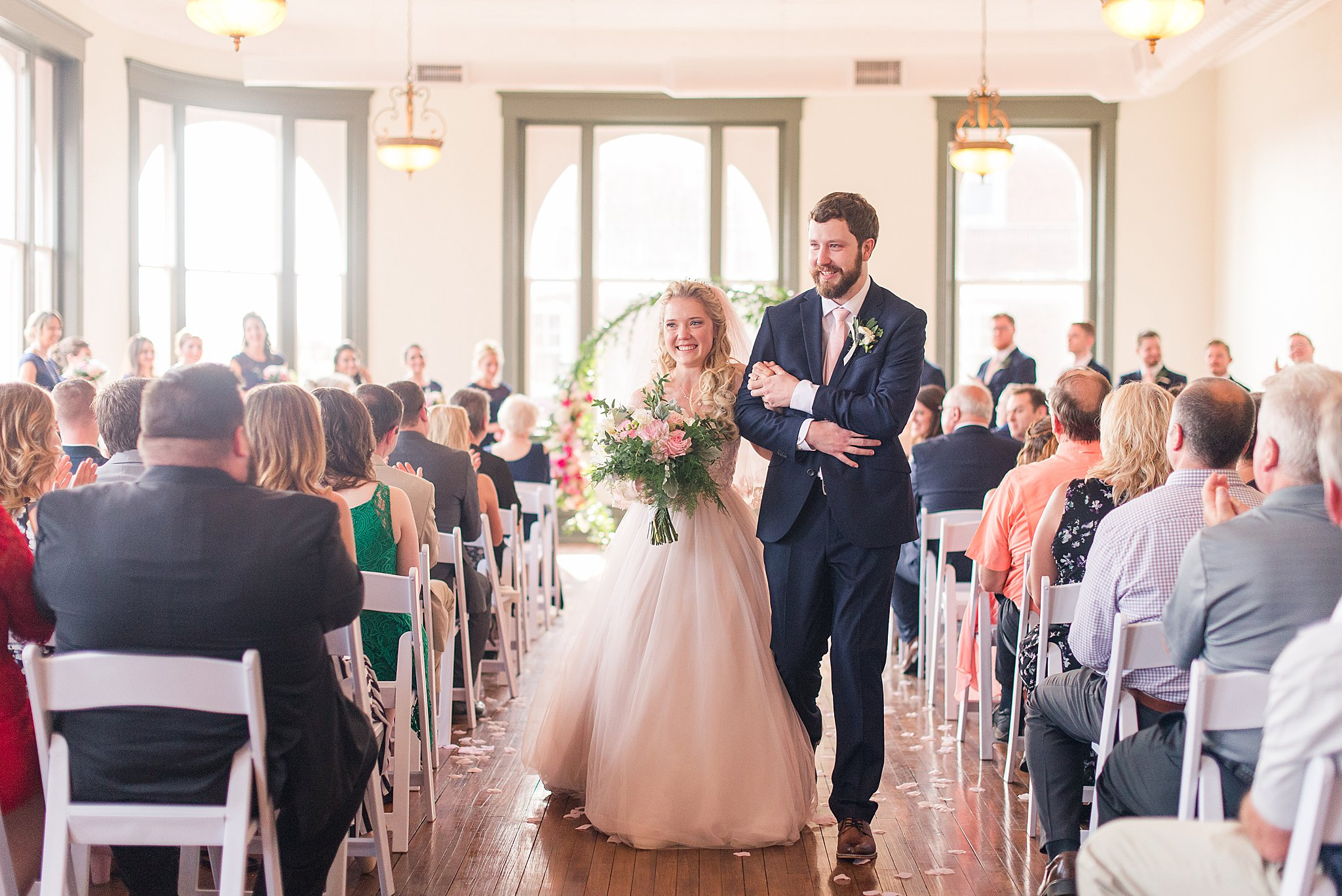 DC Couple weds at Premier West Virginia venue. Blush and Navy themed wedding in downtown Martinsburg.