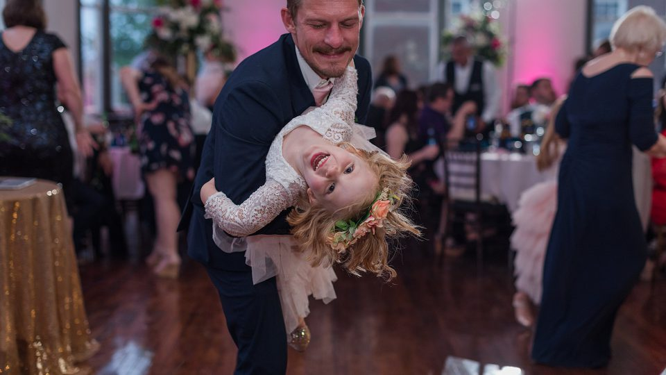 Dad dancing with the Flower Girl