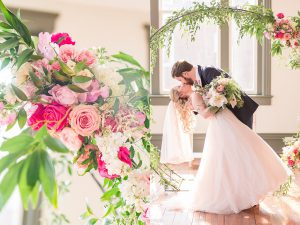 DC couple marries at new West Virginia venue, 1902 on Queen. Blush and Navy themed indoor wedding in downtown Martinsburg.