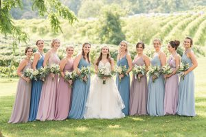 Bride and Bridesmaids blue and purple dresses during an August Wedding Day at The Stable at Bluemont in Northern Virginia.