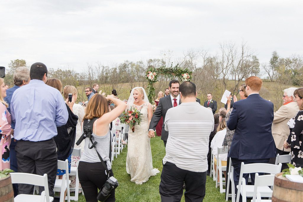 Loudoun County Photographer Behind the Scenes Wedding Recessional at The Barn at Willow Brook