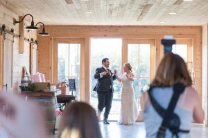Loudoun County Photographer photographing a couples entrance into The Barn at Willow Brook