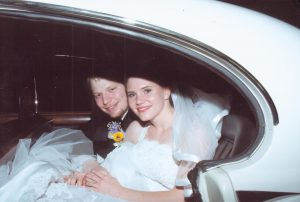 Wedding Couple leaving reception in classic car.